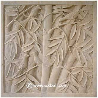 Carved stone wall insert