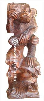 Monkey with camera wood carving