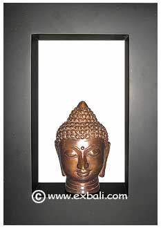 Bronze Buddha head in frame